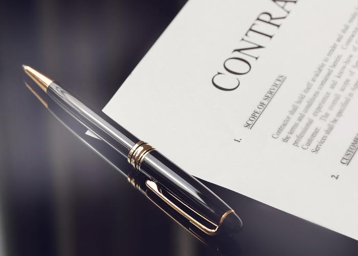 Contract and pen on desk