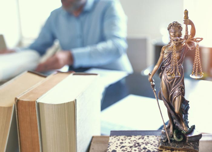Statue and Books on desk